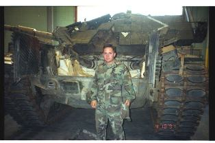 Joe Pool behind a Marine Corps tank