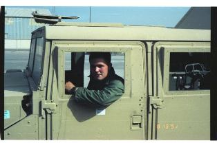 Joe Pool driving a Marine Corps Hummer